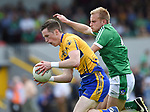 Eoin Cleary of Clare in action against Sean O Dea of Limerick during their Munster championship quarter-final game in Cusack park. Photograph by John Kelly.