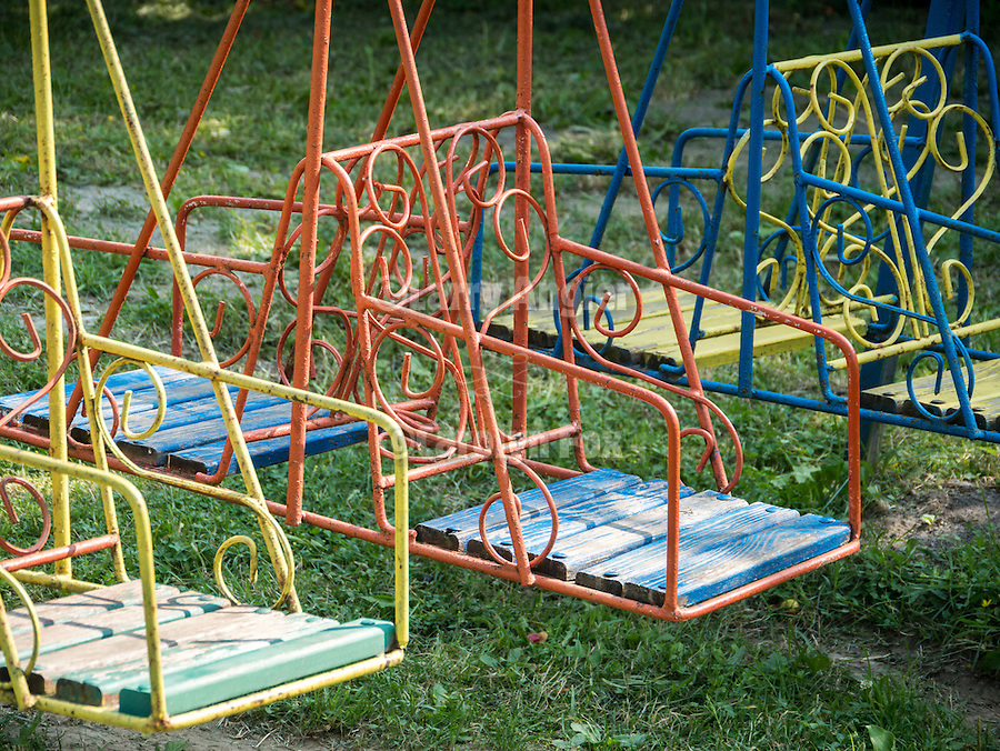 Colorful, mass-produced metal Children's swing and playground equipment, Gabrovo, Bulgaria
