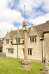 Historic stone cottages and 14th century market cross in Saxon town of Cricklade, Wiltshire, England, UK