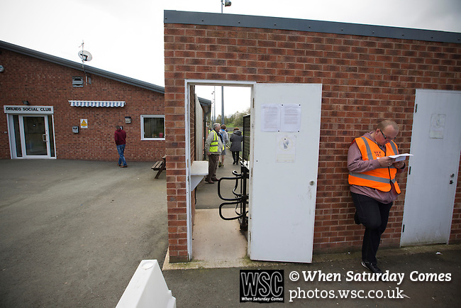 Cefn Druids AFC 1 Buckley Town 0, 12/04/2014. The Rock, Cymru Alliance league. A steward waiting for the crowd to arrive at The Rock, Rhosymedre, home to Cefn Druids AFC, prior to the club's final home game of the season against Buckley Town in the Cymru Alliance league. Druids, reputedly the oldest football club in Wales, won the Alliance league the previous week and were awarded the trophy after the Buckley Town match, which they won by 1 goal to nil, watched by a crowd of 246. The Cymru Alliance was the second tier of Welsh football based in north and mid Wales, promotion from which led directly into the Welsh Premier League. Photo by Colin McPherson.