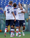 Calcio, Serie A: Roma-Bologna. Roma, stadio Olimpico, 16 settembre 2012..Bologna forward Alberto Gilardino, right, celebrates with teammates Gyorgy Garics, center, and Mikael Antonsson, at the end of the Italian Serie A football match between AS Roma and Bologna, at Rome, Olympic stadium, 16 September 2012. .UPDATE IMAGES PRESS/Isabella Bonotto