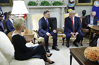 Polish First Lady Agata Kornhauser-Duda (L) watches as US President Donald J. Trump (R) shakes hands with Polish President Andrzej Duda (C) during a meeting in the Oval Office of the White House in Washington, DC, USA, 12 June 2019. Later in the day President Trump and President Duda will participate in a signing ceremony to increase military to military cooperation including the purchase of F-35 fighter jets and an increased US troop presence in Poland. <br /> Credit: Shawn Thew / Pool via CNP/AdMedia