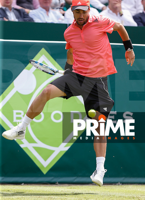Fabio Fognini (ITA) hits a shot through his legs during Fabio FOGNINI (ITA) v Fernando VERDASCO (ESP) The Boodles Tennis 2015 tournament match at Stoke Park, Stoke Poges, England on 24 June 2015. Photo by Andy Rowland.