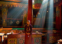 Trindu, Kham, Tibet 2006. Monk in the early morning light at Gasang Monastery.