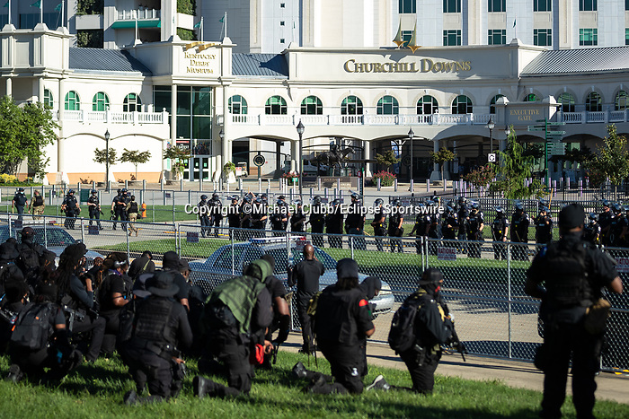 """September 5, 2020:   Members of the NFAC are met by police outside of Churchill Downs  the 146th Kentucky Derby. With the Kentucky Derby being the biggest sports event for the State of Kentucky, protestors have chosen the  event as a focal point for their calls for justice in the death of Breonna Taylor. Multiple groups from around the country have converged on Louisville to protest during the """"Run for the Roses"""" at Churchill Downs in Louisville. Michael Clubb/Eclipse Sportswire/CSM"""