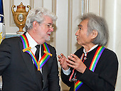 Filmmaker George Lucas, left and conductor Seiji Ozawa, right, two of the five recipients of the 38th Annual Kennedy Center Honors share a conversation prior to posing for a group photo following a dinner hosted by United States Secretary of State John F. Kerry in their honor at the U.S. Department of State in Washington, D.C. on Saturday, December 5, 2015.  The 2015 honorees are: singer-songwriter Carole King, filmmaker George Lucas, actress and singer Rita Moreno, conductor Seiji Ozawa, and actress and Broadway star Cicely Tyson.<br /> Credit: Ron Sachs / Pool via CNP