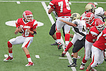 Redondo Beach, CA 10/14/10 - unknown Redondo Uion JV football players and Sam Bhatnagar (Peninsula #51) in action during the Peninsula vs Redondo Junior Varsity football game at Redondo Union HIgh School.