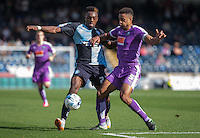 Gozie Ugwu of Wycombe Wanderers battles Curtis Nelson of Plymouth Argyle for the ball during the Sky Bet League 2 match between Wycombe Wanderers and Plymouth Argyle at Adams Park, High Wycombe, England on 12 September 2015. Photo by Andy Rowland.