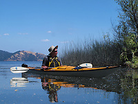 Manny Capriotti kayaking on Clear Lake,  in a kevlar Necky, Looksha IV, near Lakeport, Lake County, California