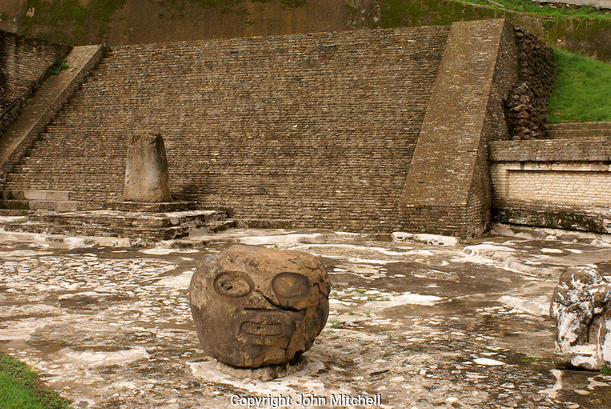 Pre-Columbian ruins and stone head in the Patio de los Atares or Patio of the Altars. Archaelogical Zone, Cholula, Puebla, Mexico Cholula is a UNESCO World Heritage Site.