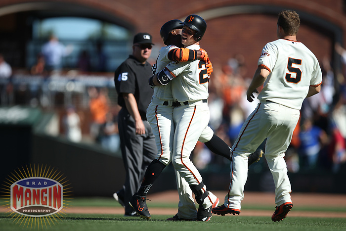 SAN FRANCISCO, CA - JULY 11:  Buster Posey #28 of the San Francisco Giants celebrates with teammate Andrew McCutchen #22 after hitting a game-winning double off the right field fence in the bottom of the 13th inning against the Chicago Cubs during the game at AT&T Park on Wednesday, July 11, 2018 in San Francisco, California. (Photo by Brad Mangin)