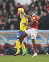 Leeds United's Ezgjan Alioski jumps with Nottingham Forest's Tendayi Darikwa<br /> <br /> Photographer Mick Walker/CameraSport<br /> <br /> The EFL Sky Bet Championship - Nottingham Forest v Leeds United - Tuesday 1st January 2019 - The City Ground - Nottingham<br /> <br /> World Copyright &copy; 2019 CameraSport. All rights reserved. 43 Linden Ave. Countesthorpe. Leicester. England. LE8 5PG - Tel: +44 (0) 116 277 4147 - admin@camerasport.com - www.camerasport.com