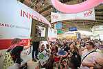 During this July 25 demonstration in the exhibit hall of the 2018 International AIDS Conference in Amsterdam, Netherlands, protestors temporarily seized the exhibits of several pharmaceutical companies, accusing them of reaping exorbitant profits from a slow and often inadequate AIDS response.