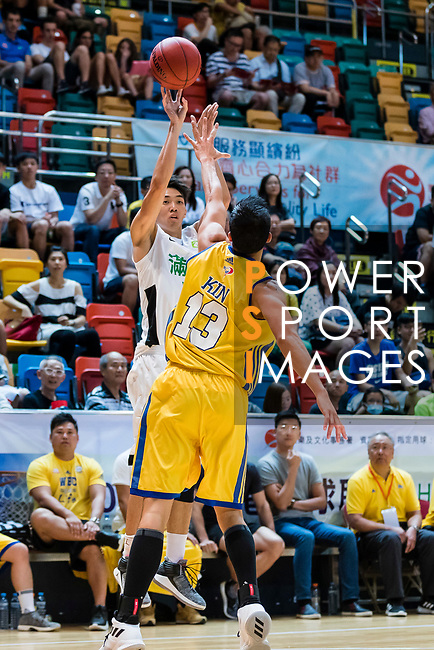 Tam Tsz Kin #12 of Tycoon Basketball Team shoots the ball against the Winling during the Hong Kong Basketball League playoff game between Tycoon and Winling at Queen Elizabeth Stadium on July 27, 2018 in Hong Kong. Photo by Yu Chun Christopher Wong / Power Sport Images
