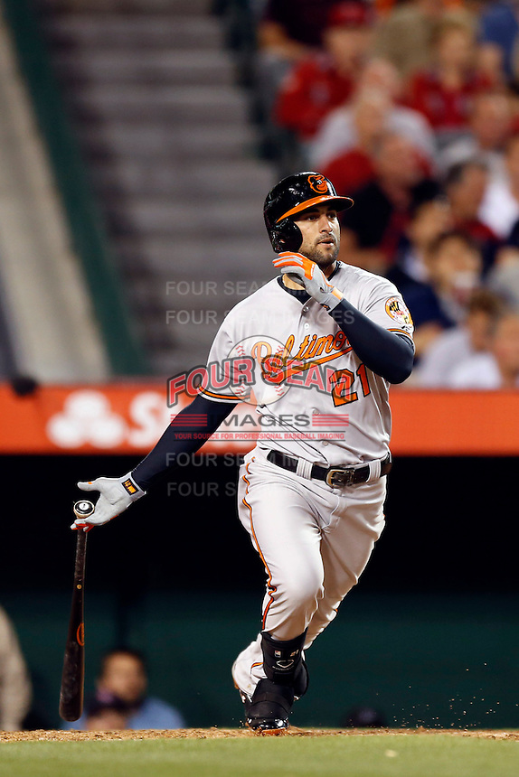 Nick Markakis #21 of the Baltimore Orioles bats against the Los Angeles Angels at Angel Stadium on May 2, 2013 in Anaheim, California. Baltimore defeated Los Angeles 5-1. (Larry Goren/Four Seam Images)
