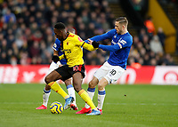 1st February 2020; Vicarage Road, Watford, Hertfordshire, England; English Premier League Football, Watford versus Everton; Danny Welbeck of Watford being challenged by Gylfi Sigurosson of Everton
