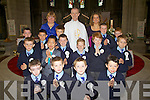 The boys from Scoil Mhuire NS Cahersiveen who made their First holy Communion on Saturday in the Daniel O'Connell Memorial Church Cahersiveen, picture here front l-r; Naoise Quirke, John O'Carroll, Ronan Clifford, Tadhg O'Connor, 2nd row l-r; Kain O'Shea, Alan Chen, Alex Coffey, Ruairi Greaney, Adam Murphy, Jack O'Connor, back l-r; Donnacha Moran, Joshua O'Sullivan, Nessa Cullinan(Principal), Daniel Sugrue, Canon Larry Kelly, Rebecca O'Connor(Teacher), Ryan Sugrue & Sam McCarthy.