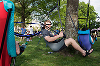 Old Main Music Festival - day party.  Students enjoy listening to local bands play during the afternoon and hang out in hanging chairs.<br />  (photo by Megan Bean / &copy; Mississippi State University)