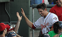 Third baseman Garin Cecchini (17) of the Greenville Drive is congratulated after scoring a run in a game against the Charleston RiverDogs on June 2, 2012, at Fluor Field at the West End in Greenville, South Carolina. Greenville won, 10-4. (Tom Priddy/Four Seam Images)