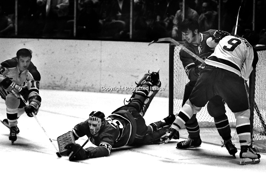 Seals vs Montreal Canadiens 1970..goalie Phil Myre,and Guy Lapointe..Seals Ted Hamson, and Bill Hickey. (photo/Ron Riesterer)