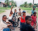 PANAMA, Bocas del Toro, kids on bikes hang in the street and wait to get access to the airport runway, Central America