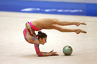 Eleni Andriola of Greece finishes with ball during qualifications at 2006 Deriugina Cup Grand Prix in Kiev, Ukraine on March 17, 2006. (Photo by Tom Theobald)