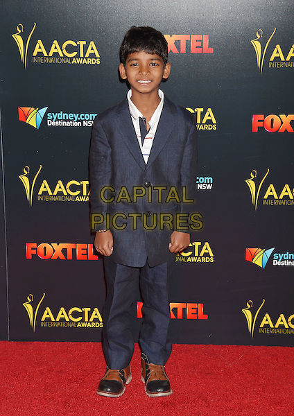 LOS ANGELES, CA - JANUARY 06: Actor Sunny Pawar arrives at the 6th AACTA International Awards at Avalon Hollywood on January 6, 2017 in Los Angeles, California.<br /> CAP/ROT/TM<br /> &copy;TM/ROT/Capital Pictures