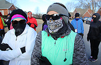 NWA Democrat-Gazette/DAVID GOTTSCHALK Tanatha Chiang (cq) (right) stands with other runners Monday, January 1, 2017, before the start of the 4th Annual Black Eyed Pea New Year's Day Run to run either the 5k or 10K course in Fayetteville. The race, organized by Doug and Pauline Allen, is free with all donations acquired going to the Fayetteville High School Cross Country teams. Snacks at the race included black eyed peas and cornbread.