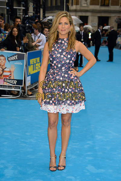 Jennifer Aniston<br /> 'We're the Millers' European UK film premiere, Empire cinema, Leicester Square, London, England.<br /> 14th August 2013<br /> full length blue pink white sleeveless floral print dress hand on hip purple<br /> CAP/CJ<br /> &copy;Chris Joseph/Capital Pictures