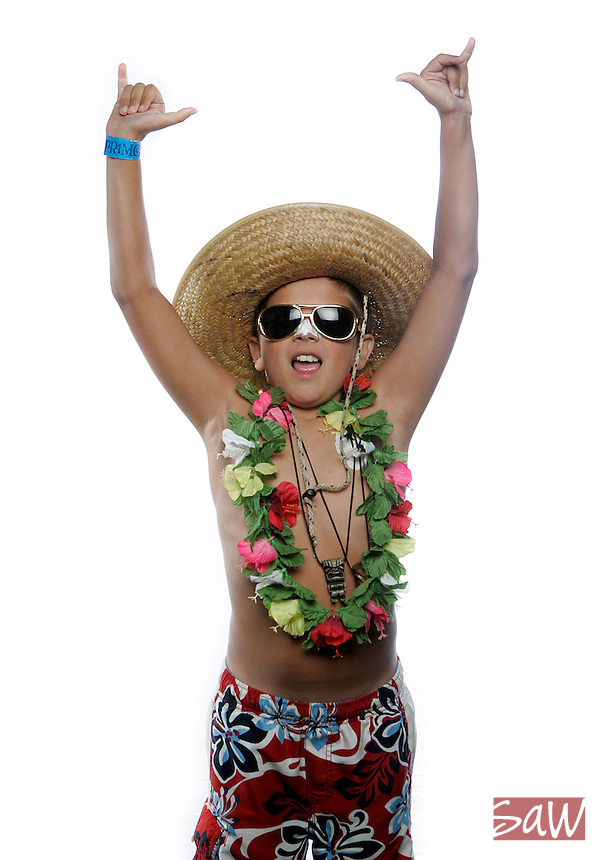 """SAN DIEGO,CA - AUGUST 14,2009: Samuel """" the little Kahuna"""" Novichi,10, of Los Angeles won the costume contest for his age catagory. Tiki Oasis 9 is the largest west coast gathering of Tiki aficianados, photographed for the IMAGE photo booth as they descended on San Diego for their annual weekend convention August 14, 2009."""