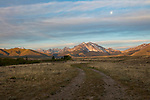 Idaho,  central, Custer County, Challis. The Lost River Range bathed in morning light with a setting moon in late spring.
