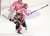 Brittany Esposito (Northeastern - 7), Kathryn Miller (BU - 4) - The Boston University Terriers defeated the visiting Northeastern University Huskies 3-2 on Saturday, January 28, 2012, at Agganis Arena in Boston, Massachusetts.