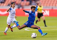 HOUSTON, TX - JANUARY 31: Roseline Eloissaint #11 of Haiti takes a shot during a game between Haiti and Costa Rica at BBVA Stadium on January 31, 2020 in Houston, Texas.