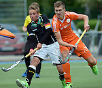 GER - Mannheim, Germany, May 16: During the whitsun tournament boys hockey match between Germany (black) and The Netherlands (orange) on May 16, 2016 at Mannheimer HC in Mannheim, Germany. Final score 4-3 (HT 2-0). (Photo by Dirk Markgraf / www.265-images.com) *** Local caption *** Hannes Mueller #3 of Germany (U16), Simon Dalderop #20 of The Netherlands