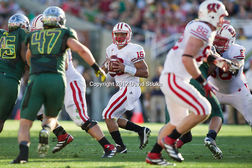 Wisconsin Badgers quarterback Russell Wilson (16) drops back to pass during the 2012 Rose Bowl NCAA football game against the Oregon Ducks in Pasadena, California on January 2, 2012. The Ducks won 45-38. (Photo by David Stluka)