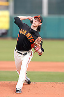 Tim Lincecum #55 of the San Francisco Giants pitches against the Arizona Diamondbacks in the first spring training game of the season at Scottsdale Stadium on February 25, 2011  in Scottsdale, Arizona. .Photo by:  Bill Mitchell/Four Seam Images.