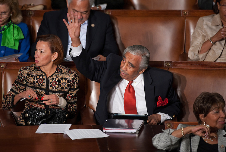 UNITED STATES - SEPTEMBER 8: Rep. Charlie Rangel, D-N.Y., waves as Rep. Nydia Velazquez, D-N.Y., looks on before President Barack Obama's speech on jobs to a joint session of Congress on Thursday, Sept. 8, 2011. (Photo By Bill Clark/Roll Call)