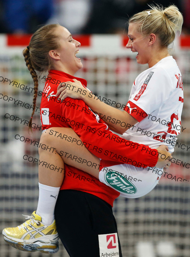 BELGRADE, SERBIA - DECEMBER 22:   Ann Grete Norgaard Osterballe (R) and  goalkeeper Cecilie Greve (L) of Denmark celebrate their victory after the World Women's Handball Championship 2013 Bronze medal match between Denmark and Poland at Kombank Arena Hall on December 22, 2013 in Belgrade, Serbia. (Photo by Srdjan Stevanovic/Getty Images)