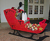 """A family of penguins and a glitter-clad sleigh greet guests at the East Visitor Entrance as part of the 2015 White House Christmas theme """"A Timeless Tradition"""" at the White House in Washington, DC on Wednesday, December 2, 2015.<br /> Credit: Ron Sachs / CNP"""