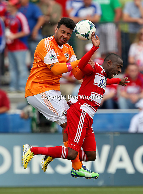 Houston Dynamo midfielder Giles Barnes (23) and FC Dallas defender Jair Benitez (5) in action during the game between the FC Dallas and the Houston Dynamo at the FC Dallas Stadium in Frisco,Texas.