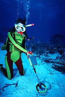 Scuba diver using underwater metal detector, treasure hunting, Turks and Caicos Islands..