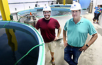 WATERBURY CT. 23 June 2017-062317SV06-From left, Matt Dawson, facility manager, and Eric Pedersen, president , stand by fish tanks used to house European sea bass  at Great American Aquaculture in Waterbury Friday. <br /> Steven Valenti Republican-American