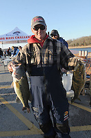 NWA Democrat-Gazette/FLIP PUTTHOFF <br /> Robbie Dodson of Harrison shows two of the bass he and his dad, Robert Dodson, caught Sunday Jan. 1 2016 to win the annual Polar Bear Memorial Bass Tournament at Beaver Lake.