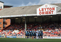The Wycombe team during the minute silence in memory of former Orient player Malcom Graham during the Sky Bet League 2 match between Leyton Orient and Wycombe Wanderers at the Matchroom Stadium, London, England on 19 September 2015. Photo by Andy Rowland.