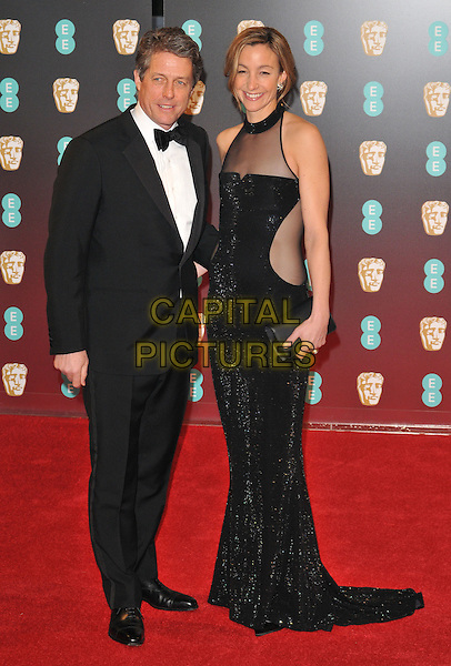 Hugh Grant and Anna Elisabet Eberstein at the EE British Academy Film Awards (BAFTAs) 2017, Royal Albert Hall, Kensington Gore, London, England, UK, on Sunday 12 February 2017.<br /> CAP/CAN<br /> &copy;CAN/Capital Pictures