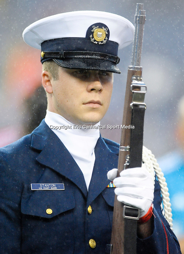 June 2 2012    A member of the US Coast Guard's Color Guard  on the field at Gillette Stadium, in  Foxborough, Massachusetts. Eric Canha/CSM