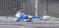 """Graham Thomas/Siloam Sunday<br /> Siloam Springs sophomore goalkeeper Alyssa Muessemeyer makes a diving stop to her right during the """"kicks from the mark"""" session of Wednesday's match against Russellville. Muessemeyer made two saves in the kicks period, but Russellville defeated Siloam Springs 1-1 (3-2 kicks)."""