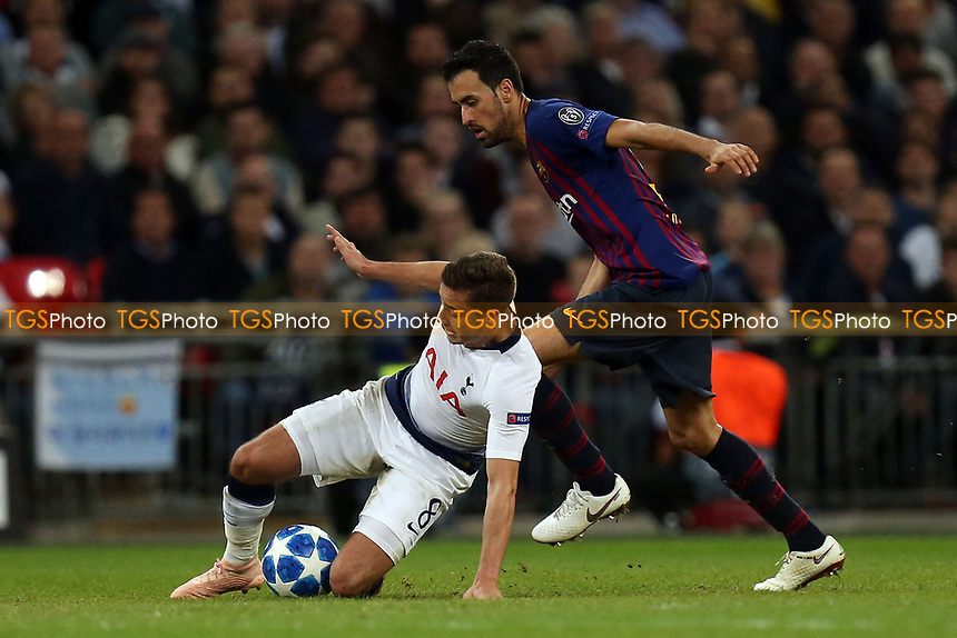 Sergio Busquets of FC Barcelona and Harry Winks of Tottenham Hotspur during Tottenham Hotspur vs FC Barcelona, UEFA Champions League Football at Wembley Stadium on 3rd October 2018