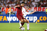 08 July 2006: Marcell Jansen (GER) (2) reaches behind Cristiano Ronaldo (POR) (17) to get a toe on the ball. Germany defeated Portugal 3-1 at the Gottlieb-Daimler Stadion in Stuttgart, Germany in match 63, the third-place game, of the 2006 FIFA World Cup.