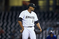 Charlotte Knights relief pitcher Juan Minaya (31) looks to his catcher for the sign against the Durham Bulls at BB&T BallPark on July 31, 2019 in Charlotte, North Carolina. The Knights defeated the Bulls 9-6. (Brian Westerholt/Four Seam Images)